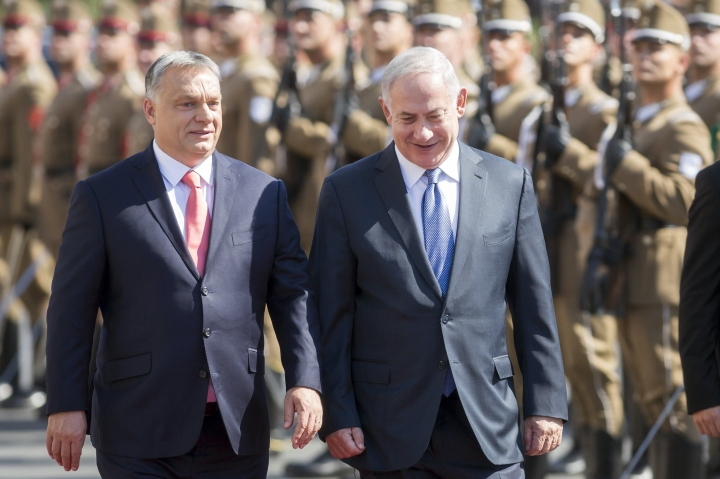 Staying on a four-day official visit in Hungary, Israeli Prime Minister Benjamin Netanyahu, right, and his Hungarian counterpart Viktor Orban inspect the honour guards during the reception ceremony in front of the Parliament building in Budapest, Hungary, Tuesday, July 18, 2017. (Balazs Mohai/MTI via AP)