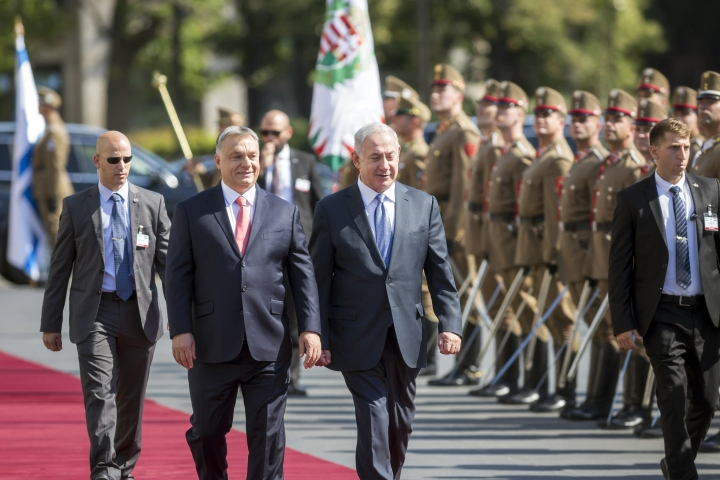 Staying on a four-day official visit in Hungary, Israeli Prime Minister Benjamin Netanyahu, right, and his Hungarian counterpart Viktor Orban inspect the honor guards during the reception ceremony in front of the Parliament building in Budapest, Hungary, Tuesday, July 18, 2017. (Balazs Mohai/MTI via AP)