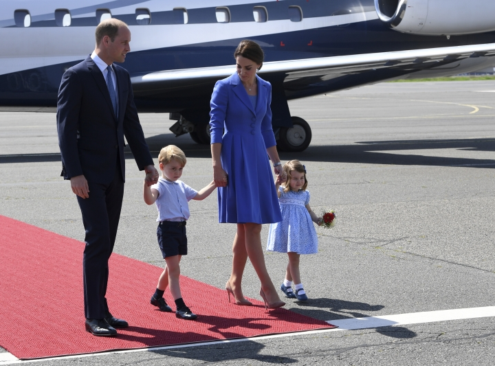 Britain's Prince William, left and Kate, the Duchess of Cambridge, second right, have arrived with their children, Prince George, second left and Princess Charlotte, at Tegel airport in Berlin, Wednesday, July 19, 2017. They arrived for a three- days-visit to Germany. William and Kate are scheduled to visit Heidelberg and Hamburg as well as Berlin. They arrived in Germany after a visit to Poland. (Bernd Von Jutrczenka/dpa via AP)