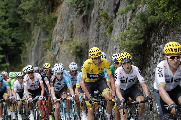 Britain's Chris Froome, wearing the overall leader's yellow jersey, and Italy's Fabio Aru, in tricolor jersey, follow Team Sky riders Poland's Michal Kwiatkowski, front, and Spain's Mikel Nieve, in second position, as they set the pace for Froome when climbing Croix de Fer pass during the seventeenth stage of the Tour de France cycling race over 183 kilometers (113.7 miles) with start in La Mure and finish in Serre-Chevalier, France, Wednesday, July 19, 2017. (AP Photo/Christophe Ena)