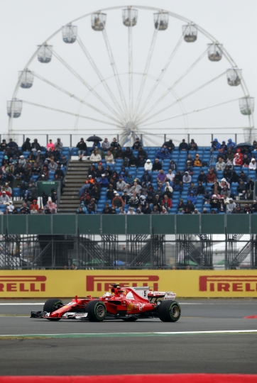 Ferrari driver Sebastian Vettel of Germany steers his car during the qualifying session for the British Formula One Grand Prix at the Silverstone racetrack in Silverstone, England, Saturday, July 15, 2017. The British Formula One Grand Prix will be held on Sunday, July 16. (AP Photo/Frank Augstein)