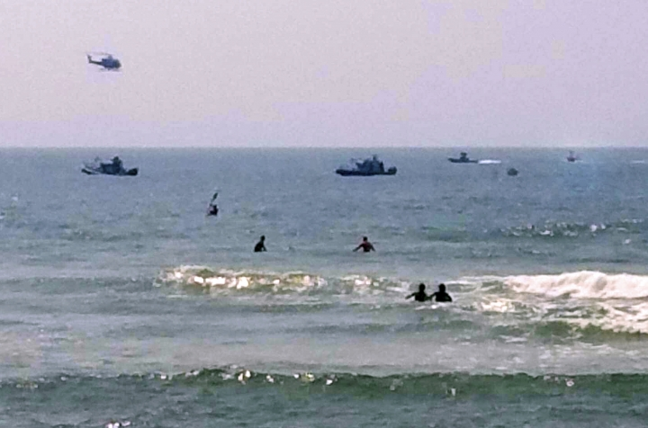 In this photo provided by ToniAnne Campasano Alvino, three rescue boats tow a helicopter that is almost entirely submerged, at far right, in the water off of Gilbo Beach, N.Y., on Long Island after the Robinson R 44 helicopter made an emergency ocean landing Wednesday, July 19, 2017. Shane McMahon, the son of World Wrestling Entertainment CEO Vince McMahon, was a passenger on the aircraft, and neither he, nor the pilot were hurt. The Federal Aviation Administration said the helicopter had taken off from Westchester County Airport in White Plains, N.Y. (ToniAnne Campasano Alvino via AP)