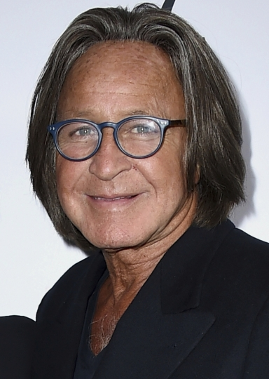 FILE - This March 20, 2016 file photo shows real estate developer Mohamed Hadid arriving at Daily Front Row's Fashion Los Angeles Awards. Hadid, the father of fashion models Bella and Gigi Hadid, has been fined and given community service for illegally building a gigantic mansion in Los Angeles' Bel Air district. The Los Angeles Times reports that Hadid was sentenced Thursday, July 20, 2017, to 200 hours of service, fined $3,000 and ordered pay the city more than $14,000 to cover building department costs. (Photo by Jordan Strauss/Invision/AP, File)