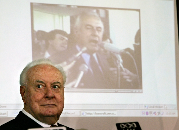 FILE - In this Nov. 7, 2005 file photo, former Australian Prime Minister Gough Whitlam watches as a film clip of his resignation speech plays behind him during a lunch in Sydney, Australia. Historian, Professor Jenny Hocking, is going to court in July, 2017 in an attempt to force Australian authorities to release secret letters that would reveal what Queen Elizabeth II knew of her representative's shocking scheme to dismiss Australia's government more than 40 years ago. (AP Photo/Mark Baker, File)