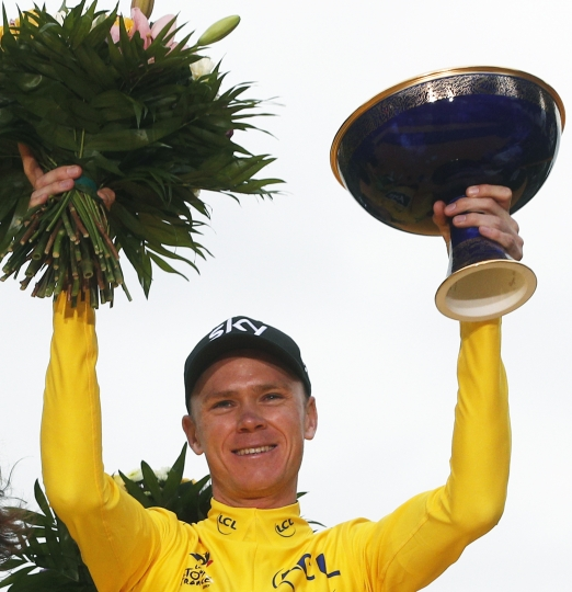 Tour de France winner Britain's Chris Froome, wearing the overall leader's yellow jersey, holds the trophy on the podium after the twenty-first and last stage of the Tour de France cycling race over 103 kilometers (64 miles) with start in Montgeron and finish in Paris, France, Sunday, July 23, 2017. (AP Photo/Christophe Ena)
