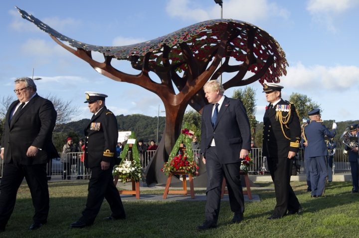 British Foreign Secretary Boris Johnson, center, walks during the service at Pukeahu National War Memorial Park in Wellington, New Zealand, Monday, July 24, 2017. Johnson is visiting the South Pacific nation for two days as Britain looks to strengthen its ties with its former colony amid a broader reshaping of Britain's global relationships as it prepares to leave the European Union.(Mark Mitchell/New Zealand herald via AP)