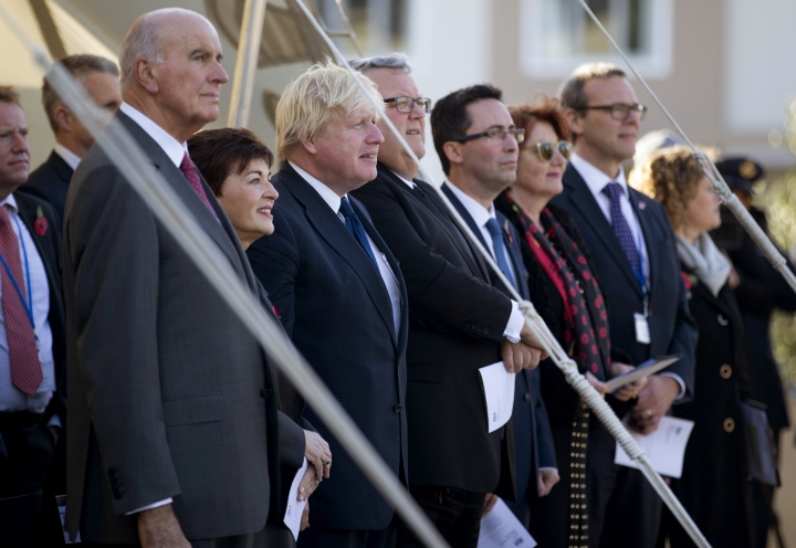 British Foreign Secretary Boris Johnson, third left, stands with New Zealand Governor General, Dame Patsy Reddy, second left, and Foreign Minister Gerry Brownlee, to his immediate right, during the service at Pukeahu National War Memorial Park in Wellington, New Zealand, Monday, July 24, 2017. Johnson is visiting the South Pacific nation for two days as Britain looks to strengthen its ties with its former colony amid a broader reshaping of Britain's global relationships as it prepares to leave the European Union.(Mark Mitchell/New Zealand Herald via AP)