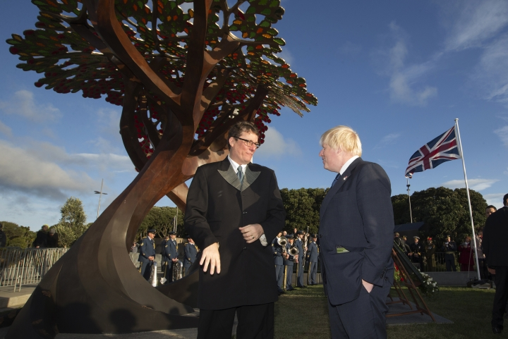 British Foreign Secretary Boris Johnson, right, talks with Weta Workshop founder Sir Richard Taylor at the Memorial at Pukeahu National War Memorial Park in Wellington, New Zealand, Monday, July 24, 2017. Johnson is visiting the South Pacific nation for two days as Britain looks to strengthen its ties with its former colony amid a broader reshaping of Britain's global relationships as it prepares to leave the European Union.(Mark Mitchell/New Zealand herald via AP)