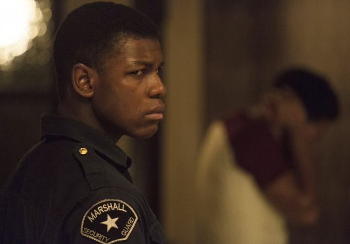 "This image released by Annapurna Pictures shows John Boyega in a scene from ""Detroit."" (Francois Duhamel/Annapurna Pictures via AP)"