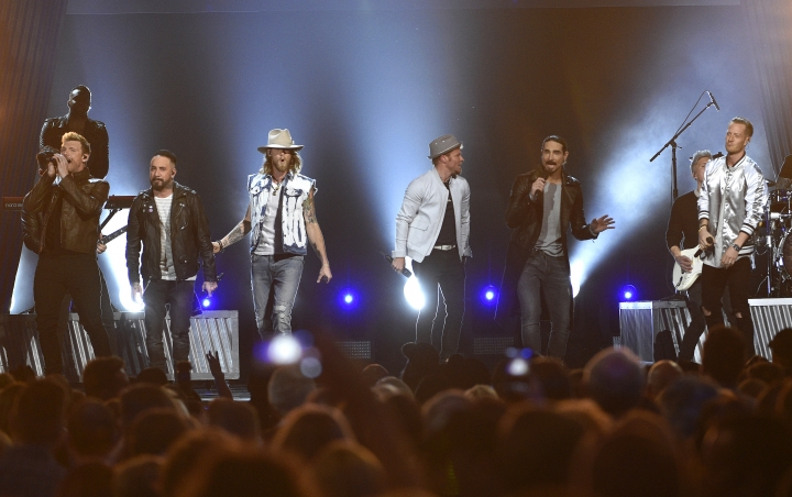 "FILE - In this April 2, 2017 file photo, Tyler Hubbard, from right, and Brian Kelley, third from left, of Florida Georgia Line, and from left, Nick Carter, AJ McLean, Brian Littrell, and Kevin Richardson, of Backstreet Boys, perform at the 52nd annual Academy of Country Music Awards in Las Vegas. Backstreet Boys got their first hit country song this year on a collaboration with country duo Florida Georgia Line and now the two powerhouse acts are teaming up for a ""CMT Crossroads"" episode airing Aug. 30. (Photo by Chris Pizzello/Invision/AP, File)"
