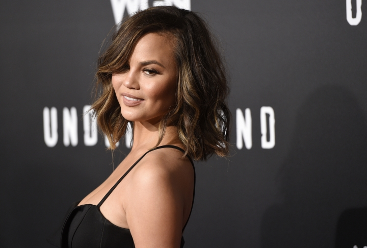 """FILE - In this Feb. 28, 2017, file photo, model Chrissy Teigen poses at the season two premiere of the television series """"Underground"""" in Los Angeles. Teigen said on Twitter July 25, 2017, that she had been blocked from President Donald Trump's personal Twitter account. (Photo by Chris Pizzello/Invision/AP, File)"""