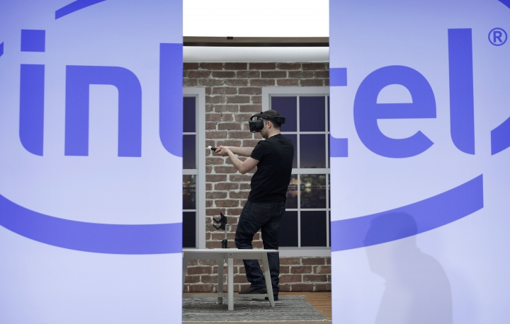 FILE - In this Wednesday, Jan. 4, 2017, file photo, a model demonstrates a Project Alloy all-in-one merged reality headset during an Intel news conference before CES International, in Las Vegas. Intel Corp. reports earnings, Thursday, July 27, 2017. (AP Photo/John Locher, File)