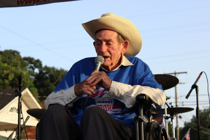 """In this July 2, 2017, photo, Cajun musician D.L. Menard sings at a tribute to him in his home town in Erath, La. Menard, whose song """"The Back Door"""" is among the most popular in Cajun music, is dead at the age of 85. Louisiana Funeral Services and Crematory in Broussard said on its website that Menard died Thursday, July 27 at his home in Scott, Louisiana. (Janet McConnaughey via AP)"""