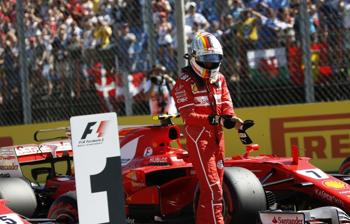 Ferrari driver Sebastian Vettel of Germany walks away from his car after he clocked the fastest time during the qualifying session for the Hungarian Formula One Grand Prix, at the Hungaroring racetrack in Mogyorod, northeast of Budapest, Saturday, July 29, 2017. The Hungarian Grand Prix will be held on Sunday, July 30. (AP Photo/Darko Bandic)