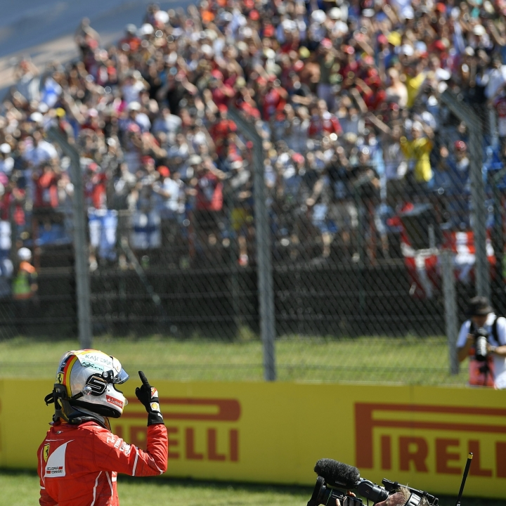 German Formula One driver Sebastian Vettel of Scuderia Ferrari celebrates during the qualifying session at Hungaroring circuit in Mogyorod, 23 kms north-east of Budapest, Hungary, Saturday, July 29, 2017. The Hungarian Formula One Grand Prix will be held on Sunday July, 30. (Zsolt Czegledi/MTI via AP)