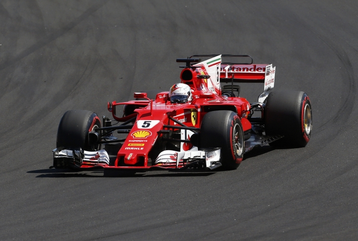 Ferrari driver Sebastian Vettel of Germany steers his car during the Hungarian Formula One Grand Prix, at the Hungaroring racetrack in Mogyorod, northeast of Budapest, Sunday, July 30, 2017. (AP Photo/Darko Bandic)