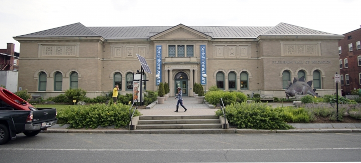 In this Wednesday, July 12, 2017 photo, a pedestrian walks past the Berkshire Museum in Pittsfield, Mass. The museum has come under intense national and local pressure after announcing earlier in the month that it is selling 40 works of art, including two by Normal Rockwell, the illustrator who called the region home for the last 30-plus years of his life. (Ben Garver/The Berkshire Eagle via AP)