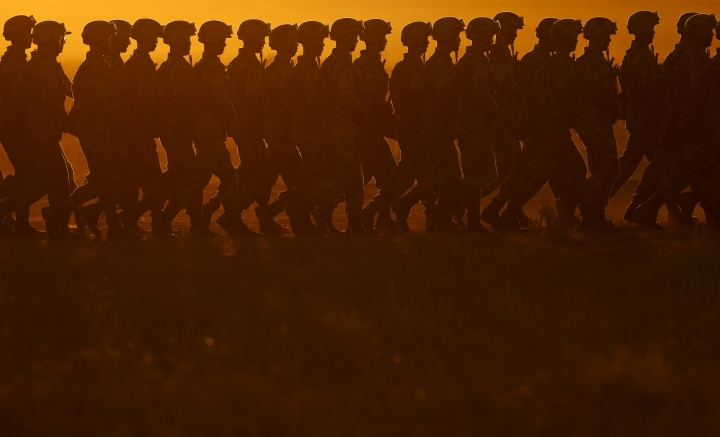 In this photo released by China's Xinhua News Agency, Chinese People's Liberation Army (PLA) troops march in formation Sunday, July 30, 2017, as they arrive for a military parade to commemorate the 90th anniversary of the founding of the PLA on Aug. 1 at Zhurihe training base in north China's Inner Mongolia Autonomous Region. (Fei Maohua/Xinhua via AP)