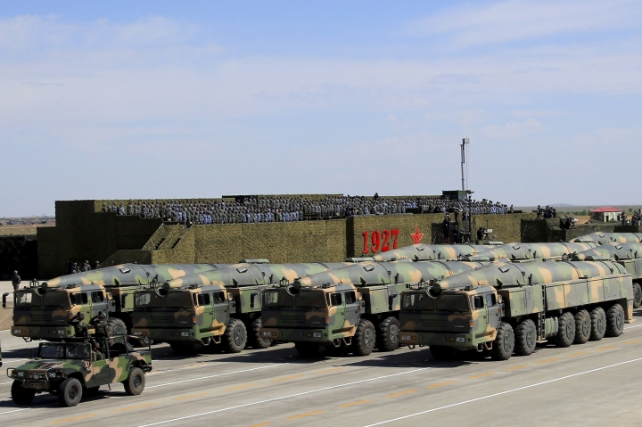 "In this photo released by China's Xinhua News Agency, military vehicles carrying missiles for both nuclear and conventional strikes are driven past the VIP stage during a military parade to commemorate the 90th anniversary of the founding of the People's Liberation Army at Zhurihe training base in north China's Inner Mongolia Autonomous Region, Sunday, July 30, 2017. China's military has the ""confidence and capability"" to bolster the country's rise into a world power, President Xi Jinping said Sunday as he oversaw a large-scale military parade meant to show off the forces at his command to foreign and domestic audiences. (Zha Chunming/Xinhua via AP)"
