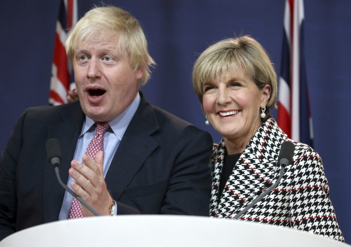 FILE - In this July 27, 2017 file photo, Australian Foreign Minister Julie Bishop, right, puts her arm around British Foreign Secretary Boris Johnson as he speaks during a press conference following their meeting in Sydney. China's foreign ministry criticized plans by Britain to send its new aircraft carriers on freedom of navigation missions in the South China Sea to challenge Beijing's expansive territorial claims in the strategic waterway. (AP Photo/Rick Rycroft, File)