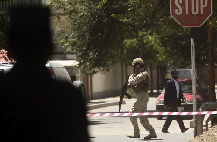 Security forces respond at the site of a suicide attack followed by a clash between Afghanistan forces and IS fighters during an attack on the Iraq embassy in Kabul, Afghanistan, Monday, July 31, 2017. A media outlet linked to the Islamic State group says two IS militants were behind the attack on the Iraqi Embassy in the Afghan capital. (AP Photos/Massoud Hossaini)