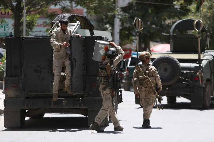Afghan security forces arrive at the site of complex attack in Kabul, Afghanistan, Monday, July 31, 2017. Afghan police say a car bombing has targeted the Iraqi Embassy in central Kabul, followed by gunfire, and that the attack is still underway. (AP Photo/ Rahmat Gul)