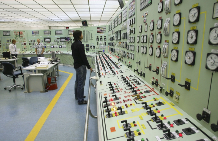FILE - In this Oct. 6, 2009 file photo, of a worker as he checks the controls inside the control room of the nuclear power plant of Santa Maria de Garona in Spain. The Spanish government said on Tuesday Aug. 1, 2017 that it is closing the country's oldest nuclear power station Santa Maria de Garona, because of lack of support among political parties and companies involved to keep it open and uncertainty surrounding the plant's viability. (AP Photo/I.Lopez, File)