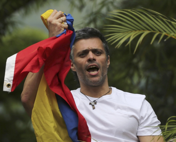 FILE - In this Saturday, July 8, 2017, file photo, Venezuela's opposition leader Leopoldo Lopez holds a national flag as he greets supporters outside his home in Caracas, Venezuela, following his release from prison and being placed under house arrest after more than three years in military lockup. Allies of two Venezuelan opposition leaders say Lopez and Antonio Ledezma have been taken by authorities from the homes where they were under house arrest. Video posted on the Twitter account of Lopez's wife early Tuesday, Aug. 1, shows a man being taken away from a Caracas home by state security agents. (AP Photo/Fernando Llano, File)