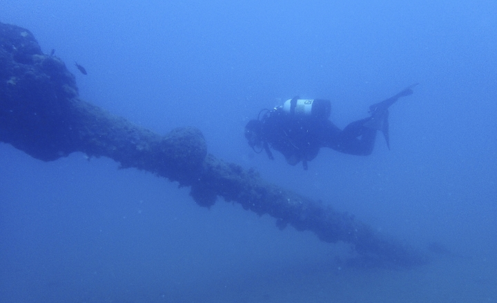 In this Tuesday, July 18, 2017 photo, maritime ecologist Derek Smith of the RPM Nautical Foundation observes marine life growing on part of the Italian World War II shipwreck MV Probitas in Saranda Bay, southern Albania. On the seabed off the rugged shores of Albania, one of the world's least explored underwater coastlines, lies a wealth of treasures. Ancient amphorae that carried olive oil and wine; wrecks with hidden tales of heroism and treachery from two world wars; spectacular rock formations and marine life. (AP Photo/Elena Becatoros)