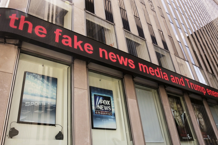 News headlines scroll above the Fox News studios in the News Corporation headquarters building in New York, Tuesday, Aug. 1, 2017. Fox contributor Rod Wheeler, who worked on the Seth Rich case, claims Fox News fabricated quotes implicating the murdered Democratic National Committee staffer in the Wikileaks scandal and that President Donald Trump pressured Fox to publish the story. He sued Fox for defamation on Tuesday. (AP Photo/Richard Drew)