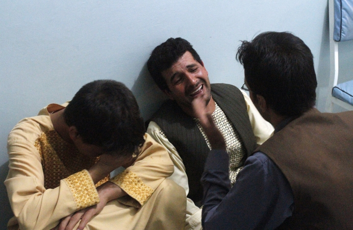 CORRECTS CITY TO HERAT - Relatives mourn after a suicide attack on a mosque in Herat, Afghanistan, Tuesday, Aug. 1, 2017. An Afghan hospital official says an explosion inside a minority Shiite mosque in western Herat, on the border with Iran, has killed at least 20 people.(AP Photo/Hamed Sarfarazi)