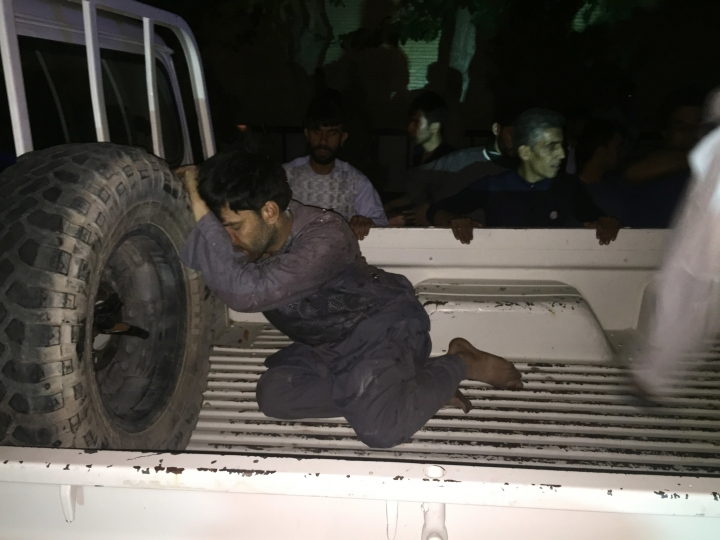 CORRECTS CITY TO HERAT - A wounded man rests on a vehicle after a suicide attack on a mosque in Herat, Afghanistan, Tuesday, Aug. 1, 2017. An Afghan hospital official says an explosion inside a minority Shiite mosque in western Herat, on the border with Iran, has killed at least 20 people.(AP Photo/Hamed Sarfarazi)