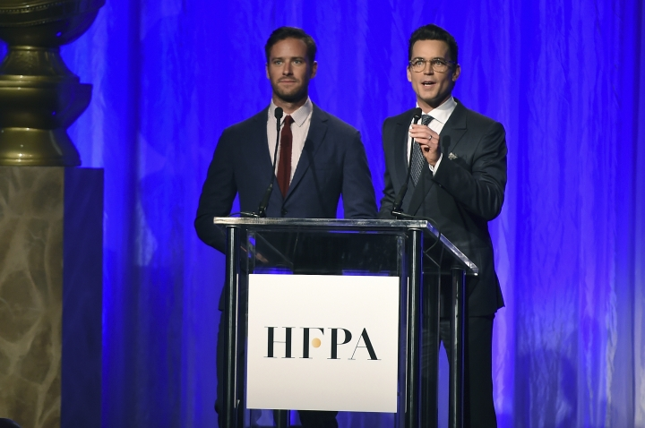 Armie Hammer, left, and Matt Bomer speak at the Hollywood Foreign Press Association Grants Banquet at the Beverly Wilshire Hotel on Wednesday, Aug. 2, 2017, in Beverly Hills, Calif. (Photo by Jordan Strauss/Invision/AP)