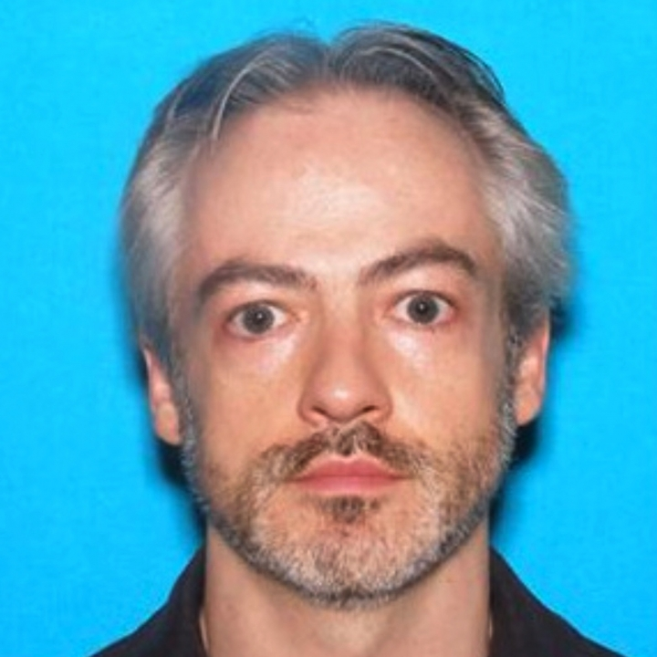 This undated photo released by the Chicago Police Department shows Wyndham Lathem, an associate professor of microbiology and immunology at Northwestern University. An arrest warrant was issued Monday, July 31, 2017, for Lathem and another man in connection to the stabbing death of a Chicago man on July 27. (Chicago Police Department via AP)
