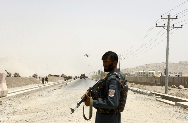 An Afghan policeman stands guard near to the site of a suicide bomber struck at a NATO convoy in Kandahar southern of Kabul, Afghanistan, Wednesday, Aug. 2, 2017. A suicide bomber struck a NATO convoy near the southern Afghan city of Kandahar on Wednesday, causing casualties, the U.S. military said. (AP Photo)