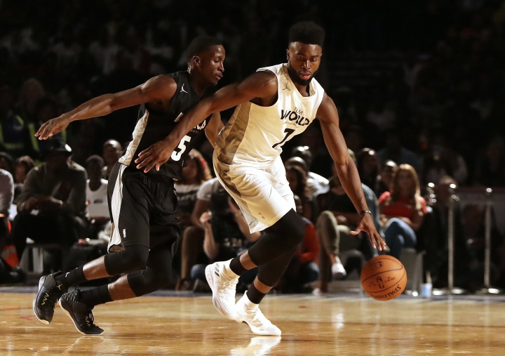 Team World's Jaylen Brown of Boston Celtics, right, drives the ball away from Team Africa's Victor Oladipo of Indiana Pacers, during the NBA Africa Game between Team Africa and Team World, at the Dome in Johannesburg, South Africa, Saturday, Aug. 5, 2017. (AP Photo/Themba Hadebe)