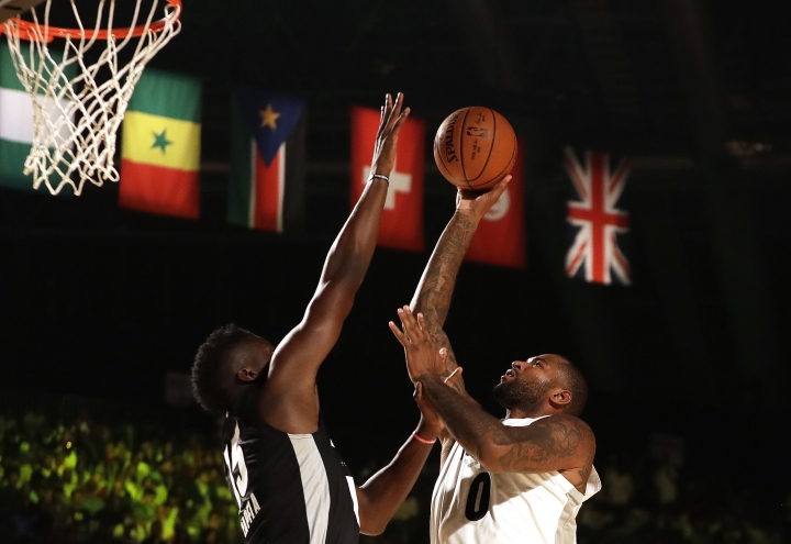 Team Africa's Luc Mbah a Moute of Houston Rockets, left, blocks a shot by Team World's DeMarcus Cousin of New Orleans Pelicans, right, during the NBA Africa Game between Team Africa and Team World, at the Dome in Johannesburg, South Africa, Saturday, Aug. 5, 2017. (AP Photo/Themba Hadebe)