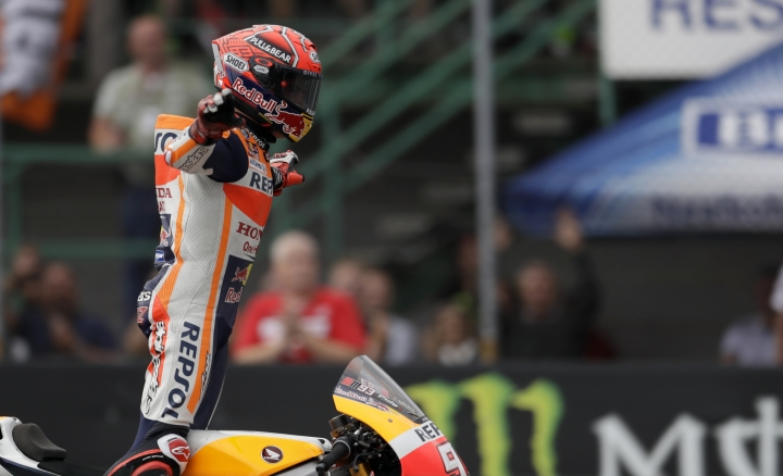 Spain's MotoGP rider Marc Marquez of the Repsol Honda Team celebrates his victory in the MotoGP race at the Czech Republic motorcycle Grand Prix at the Automotodrom Brno, in Brno, Czech Republic, Sunday, Aug. 6, 2017. (AP Photo/Petr David Josek)