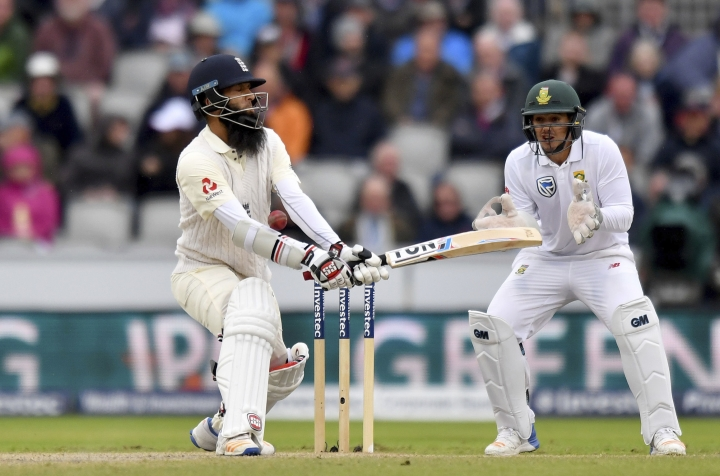 England's Moeen Ali, left, is struck by the ball during day three of the Fourth Test match against South Africa at Emirates Old Trafford in Manchester, England, Sunday Aug. 6, 2017. (Anthony Devlin/PA via AP)