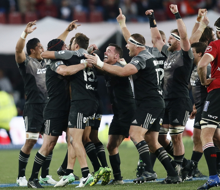 The Crusaders team celebrate their Super Rugby final win against South Africa's Lions, at Ellis Park stadium in Johannesburg, Saturday, Aug. 5, 2017. (AP Photo/Phil Magakoe)
