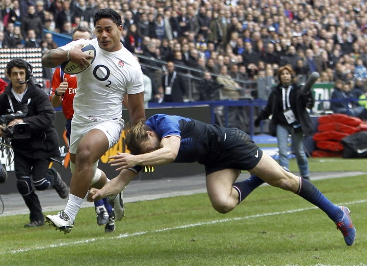 """FILE - This is a Sunday, March 11, 2012 file photo of England's Manu Tuilagi, left, as he runs to score a try despite the tackle of France's Aurelien Rougerie during their six nations rugby union match at the Stade de France stadium, in Saint Denis, outside Paris, Sunday. England's Rugby Football Union said Monday Aug. 7, 2017 that Manu Tuilagi and Denny Solomona have been sent home from a national team training camp. An RFU statement says the disciplinary action is a result of """"culture issues"""" with no further explanation provided. (AP Photo/Christophe Ena/File)"""