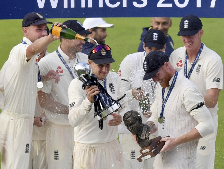 England celebrate winning the series, after winning the Fourth Test against South Africa at Emirates Old Trafford in Manchester, England, Monday Aug. 7, 2017. (Anthony Devlin/PA via AP)