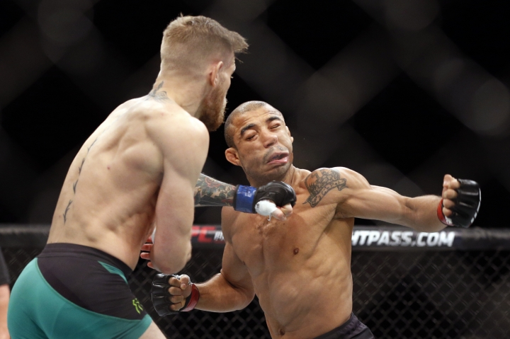 In this Dec. 12, 2015, file photo, Conor McGregor, left, fights Jose Aldo during a featherweight championship mixed martial arts bout at UFC 194 in Las Vegas. Aldo believes McGregor has no chance to accomplish a stunning upset of Floyd Mayweather when the fighters meet in a boxing match Aug. 26, 2017, in Las Vegas. (AP Photo/John Locher, File)
