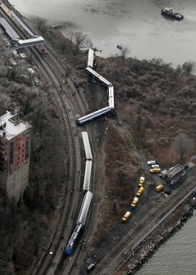 "FILE - In this Dec. 1, 2013 file photo, a Metro-North passenger train lays on its side after derailing on a curved section of track, killing four people, in the Bronx borough of New York. The National Transportation Safety Board concluded that William Rockefeller, who was the engineer on the commuter train, had ""severe obstructive sleep apnea."" Safety experts say millions of lives will be at risk now that U.S. officials have dropped plans to require that truck drivers and train engineers be screened for sleep apnea. Officials say testing should be left up to railroads and trucking companies. One railroad that does test, Metro-North in the New York City suburbs, found that 11.6 percent of its engineers have sleep apnea. (AP Photo/Mark Lennihan, File)"