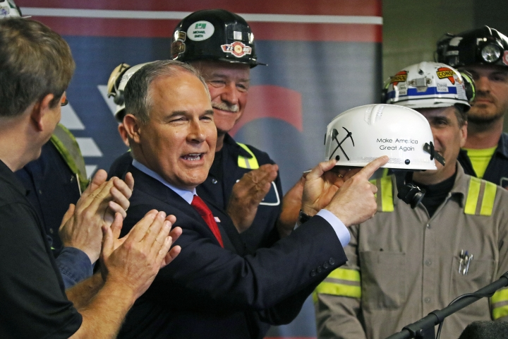 "FILE - In this April 13, 2017, file photo, Environmental Protection Agency Administrator Scott Pruitt holds up a hardhat he was given during a visit to Consol Pennsylvania Coal Company's Harvey Mine in Sycamore, Pa. As President Donald Trump touts new oil pipelines and pledges to revive the nation's struggling coal mines, federal scientists are warning that burning fossil fuels is already driving a steep increase in the United States of heat waves, droughts and floods. Faced with reams of evidence complied by federal scientists that conflicts with their policy positions, Trump and his advisers frequently cite the work of industry-funded think tanks. Pruitt and Energy Secretary Rick Perry have championed the formation of a ""red-team, blue-team"" exercise where climate-change skeptics would publicly debate mainstream climate scientists.(AP Photo/Gene J. Puskar, File)"