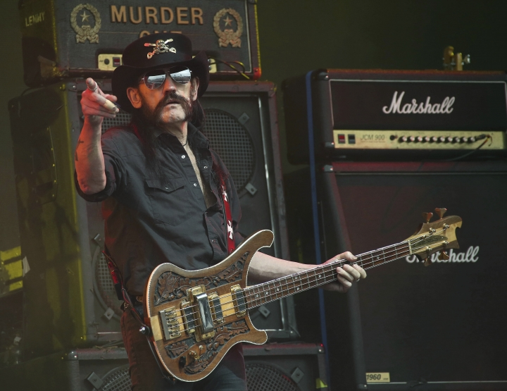 FILE - This June 26, 2015 file photo shows Motorhead bassist Lemmy Kilmister performing on the Pyramid stage during Glastonbury Music Festival at Worthy Farm, Glastonbury, England. London's Natural History Museum announced Aug. 8, 2017, that scientists have named a prehistoric crocodile after Kilmister. (Photo by Joel Ryan/Invision/AP, File)