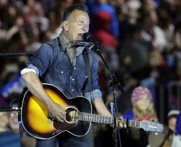 "FILE - In this Nov. 7, 2016, file photo Bruce Springsteen performs during a Hillary Clinton campaign event at Independence Mall in Philadelphia. Springsteen plans to make his Broadway debut onstage this fall at the Walter Kerr Theatre in a solo show in which he performs songs from his career, interspersed with readings of his best-selling memoir ""Born to Run."" ""Springsteen on Broadway"" begins previews Oct. 3, 2017, ahead of an Oct. 12 opening. (AP Photo/Matt Slocum, File)"