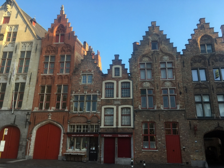 This June 13, 2017 photo shows a row of gilded houses in Bruges, Belgium. Some of the houses date to the 16th Century and avoided damage during both world wars, leaving much of the city as it was centuries ago. (AP Photo/John Marshall)