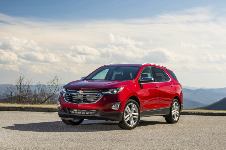 This photo provided by General Motors Co. shows the 2018 Chevrolet Equinox, an example of a vehicle that has features parents will love. One feature in particular is the installation of multiple USB charging ports, which give all passengers the ability to charge mobile devices while traveling. (Jessica Lynn Walker/Courtesy of General Motors Co. via AP)