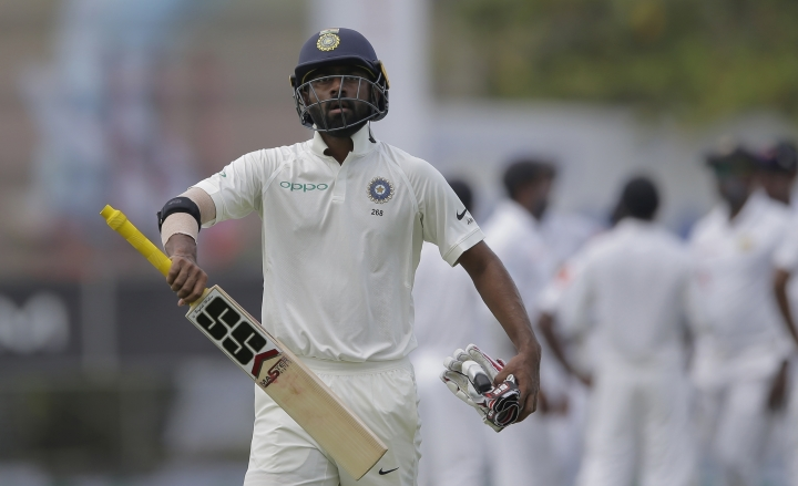 "FILE - In this July 26, 2017 file photo, India's Abhinav Mukund during the first test cricket match between India and Sri Lanka in Galle, Sri Lanka. In a series of Twitter posts, including one long statement, batsman Abhinav Mukund said people had been ""posting abuses"" and ""saying absolutely derogatory things about the tone of my skin."". (AP Photo/Eranga Jayawardena, File)"